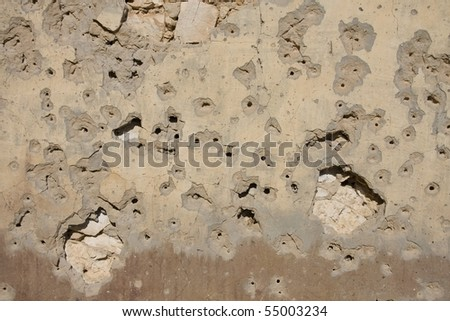 bullet holes on old wall - stock photo