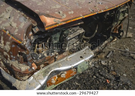 Bullet riddled truck cab with mud splatter and paint ball splats. - stock photo