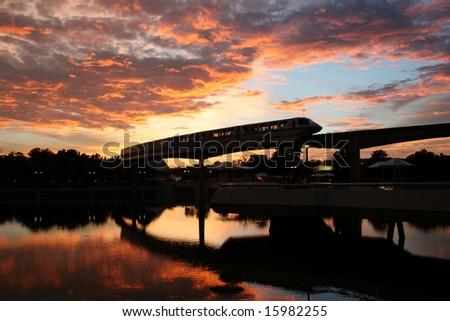 Bullet train at sunset - stock photo