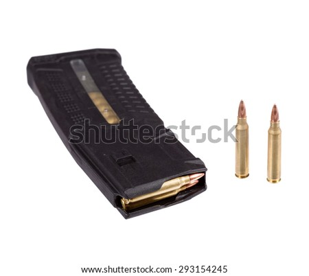 Bulletes and high capacity magazine that goes into a modern assault rifle. - stock photo