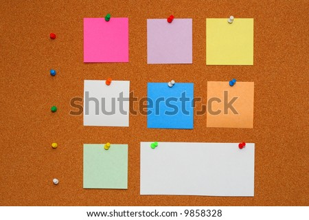 Bulletin board with pinned papers.Color pins with color note paper.
