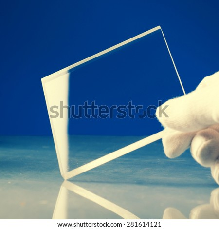 Bulletproof super hard glass based on structured nanocrystals. Toned photo - stock photo