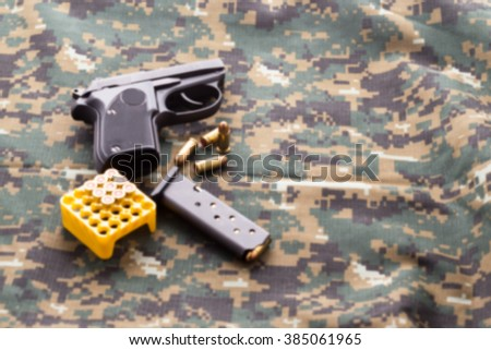 bullets and black gun pistol on military drill - stock photo