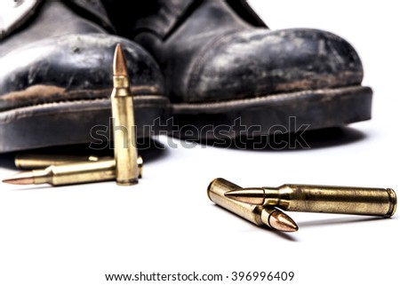 Bullets and boots isolated on white background with shadow
