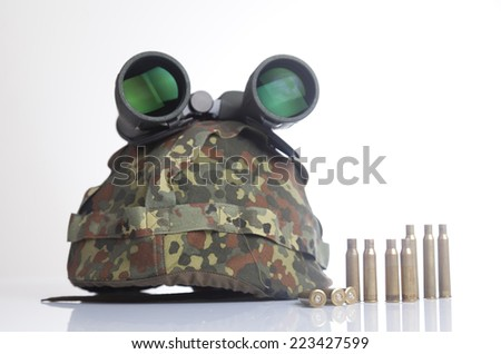 Bullets and military helmet and binoculars isolated on a white background - stock photo