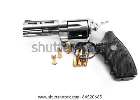 Bullets and revolver. Not real gun (lighter) - stock photo