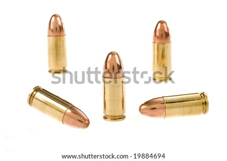 Bullets for a revolver pistol isolated on a white background. - stock photo