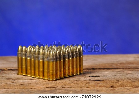 Bullets on old vintage wood table with copy space - stock photo