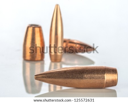bullets on white background with reflection - stock photo