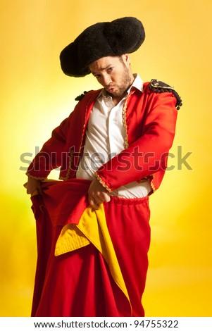 Bullfighter courage red yellow humor spanish colors - stock photo