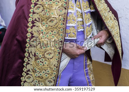 "Bullfighter getting dressed for the ""paseillo"" or initial parade, Spain"
