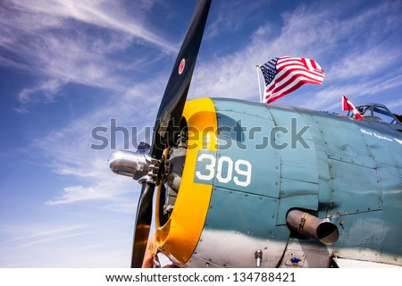BULLHEAD CITY, ARIZONA - APRIL 6: Engine cowling and propeller of a classic World War II era TBF Avenger torpedo bomber on display at Bullhead City, AZ airshow, April 6, 2013. - stock photo
