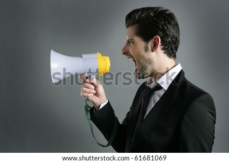 bullhorn businessman megaphone profile shouting loud - stock photo