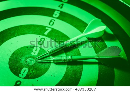 Bulls eye and Dart is an opportunity and Dartboard is the target and goal. So both of that represent a challenge. There is an opportunity, risk management of business concept. - Green Tone.