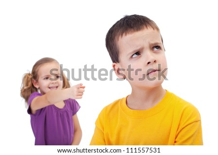 Bullying concept - girl mocking an upset young boy, isolated - stock photo