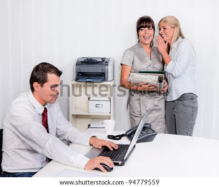 bullying in the workplace an office. two laugh about colleagues - stock photo