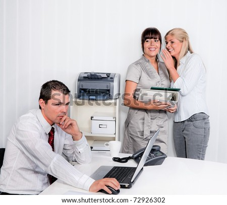 Bullying in the workplace an office. Women make fun of men - stock photo