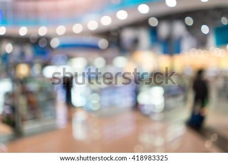 Bulr abstract image of shopping mall and department store use as background. - stock photo