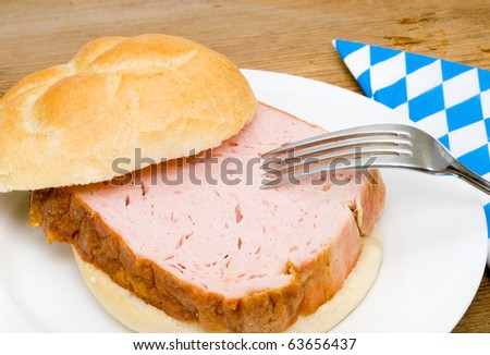 Bum with so called Leberkaese - stock photo