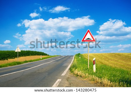 Bump caution sign on the road - stock photo