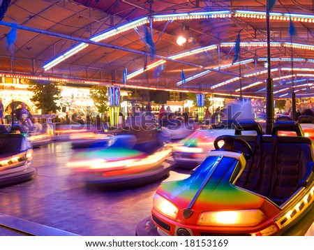 Bumper cars in motion - stock photo