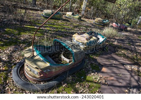 Bumper cars in Pripyat ghost town in Chernobyl Exclusion Zone, Ukraine - stock photo