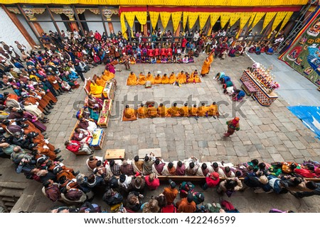 Bumthang, Bhutan, 06 Nov 2011: Huge crowds gathered in their traditional costumes to watch the annual tsechu festival at Jakar Dzong. - stock photo