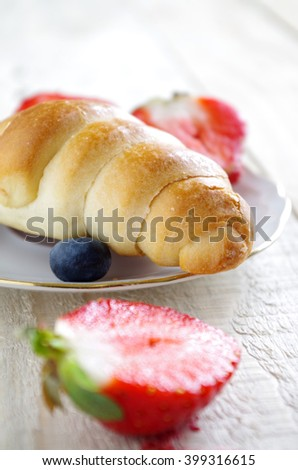 bun and berries on the breakfast table