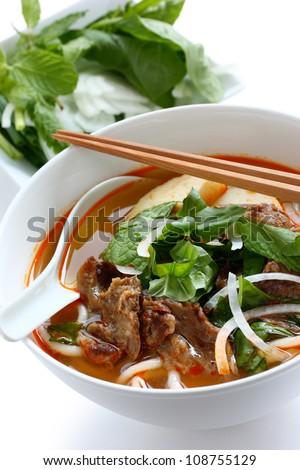 bun bo hue, a bowl of beef & rice vermicelli soup, vietnamese noodle cuisine