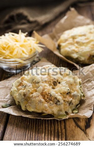 Bun gratinated with Cheese on rustic wooden background