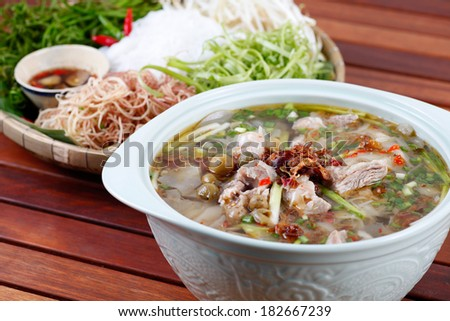 BUN HEO NAU CHUA - Sour pork soup eating with rice noodle, Vietnamese people usually eat this dish during a hot summer season. - stock photo
