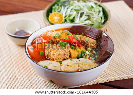 BUN RIEU -  a typical traditional Vietnamese noodle ( different from PHO NODDLE), the ingredients are: rice noodle, minced pork, meat of crab, and severed with vegetable - stock photo