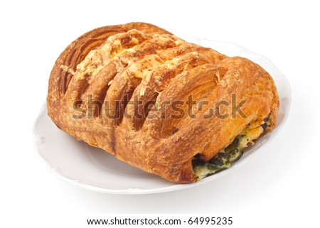 Bun with cheese and spinach on a plate on white background