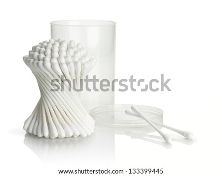 Bunch and separate cotton buds with plastic packing on a white background - stock photo