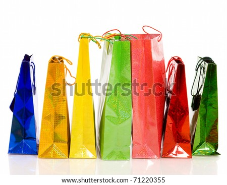 Bunch colorful paper bags for gifts isolated on white - stock photo