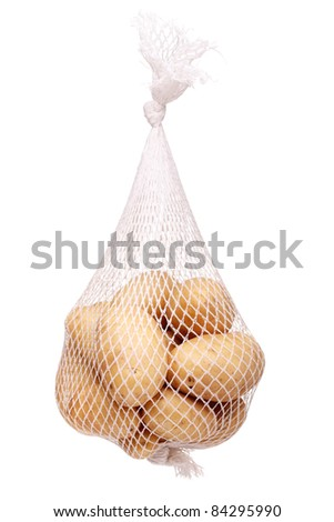 bunch fresh potatoes in a white mesh bag - stock photo