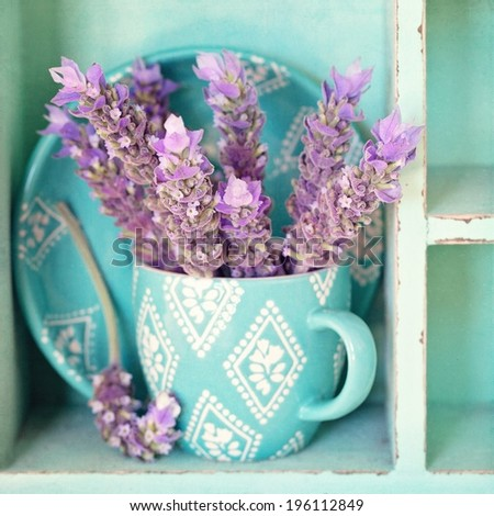 bunch of a lavender flowers in a blue tea mug . - stock photo