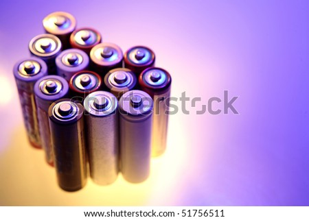 Bunch of AA size batteries - stock photo