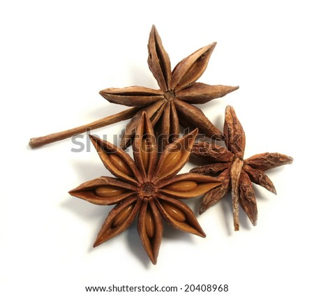 Bunch of anise stars on white background