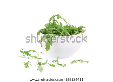 Bunch of arugula close up. Isolated on a white background.