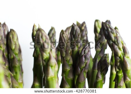 Bunch of asparagus on a table. Uncooked pile raw for organic, vegetarian cuisine, delicious fresh, healthy ingredient. Closeup and copy space. - stock photo