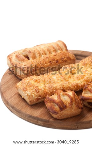 Bunch of bakery products on a wooden board.