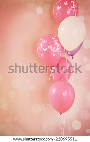 Bunch of balloons against a pink background - stock photo