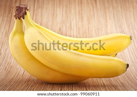 bunch of bananas fruit on a wooden background - stock photo