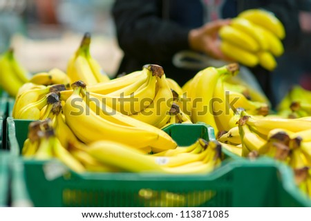 Bunch of bananas in boxes in supermarket - stock photo