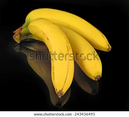 Bunch of bananas on black background - stock photo