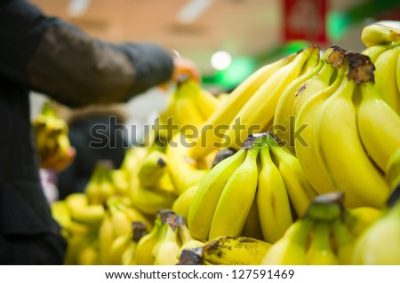 Bunch of bananas on boxes in supermarket - stock photo