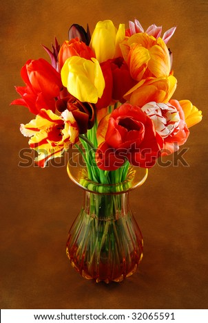 Bunch of beautiful spring flowers - colorful tulips in a vase against brown background - stock photo