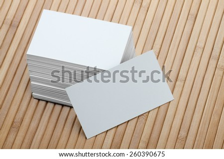 Bunch of Blank White Business Card on Wooden Background - stock photo