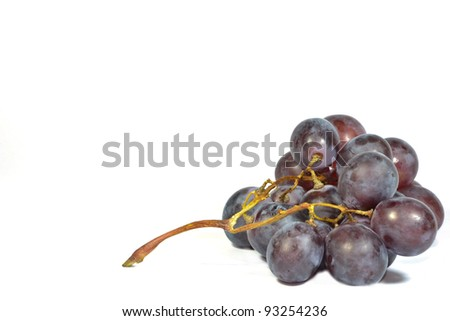 bunch of blue grapes isolated on white - stock photo
